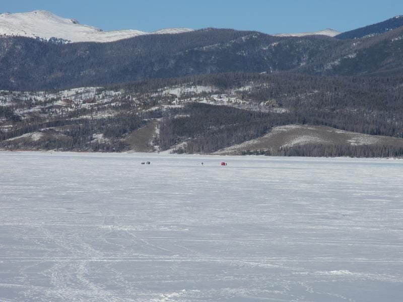 Ice fishing huts in the distance for Lake granby fishing report