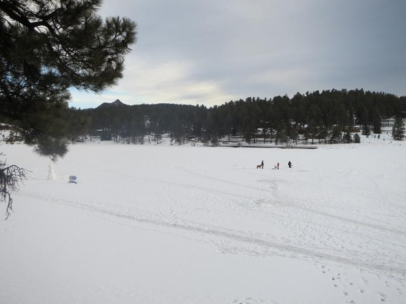 Frozen fishing on evergreen lake ice fishing in for Where to buy fishing license colorado