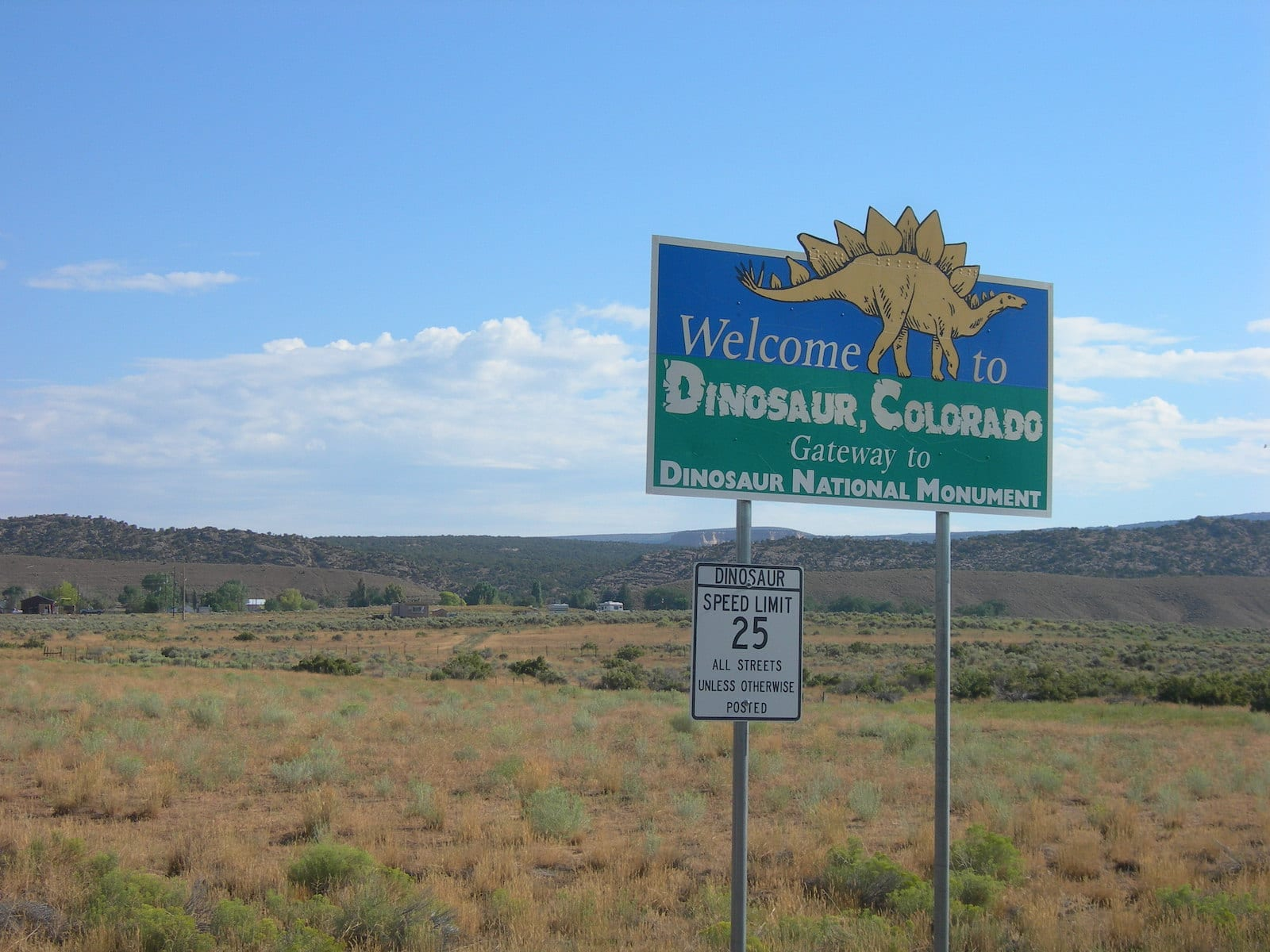 Colorado Town Motto Dinosaur Welcome Sign