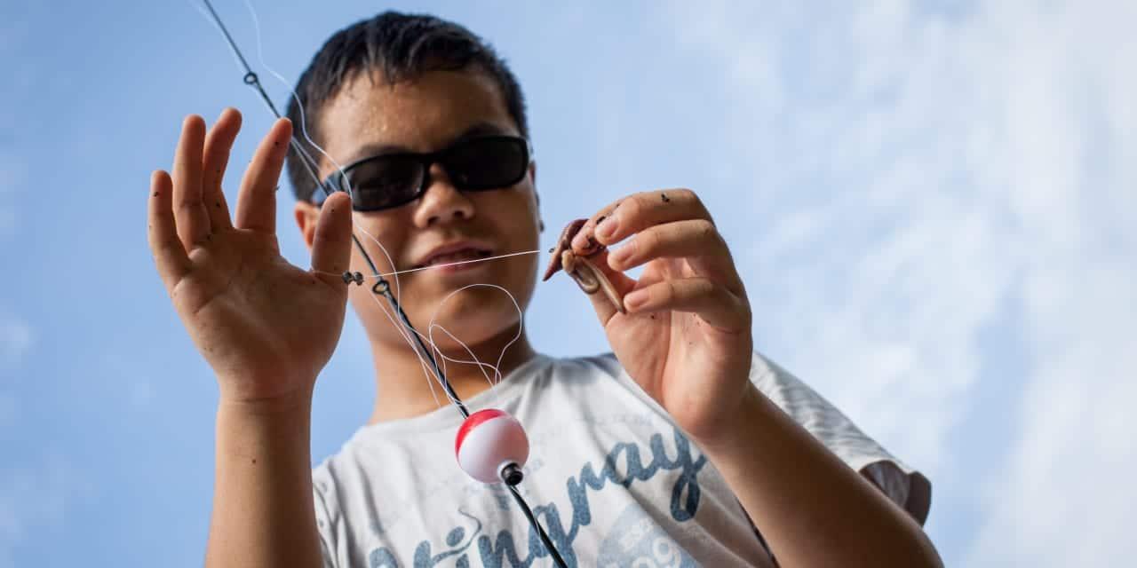 Boy Fishing Nightcrawler