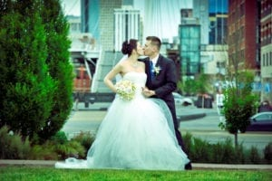 Married In Denver Colorado Wedding Couple Kiss Downtown