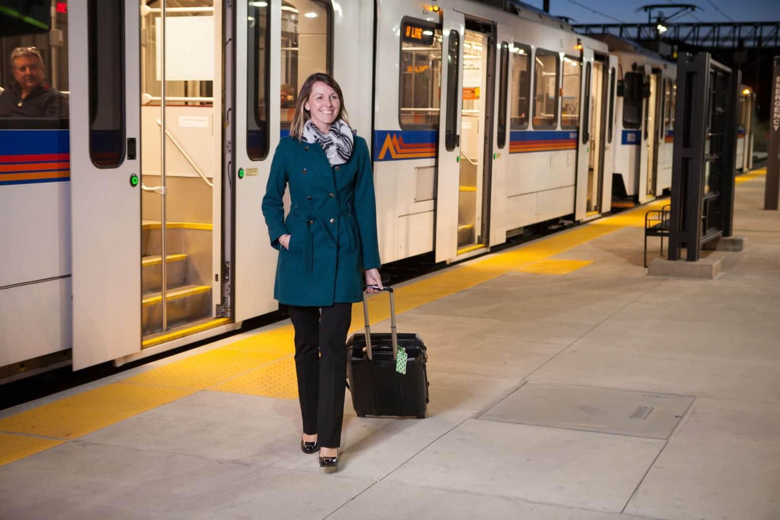 RTD Train Business Woman Exiting Light Rail