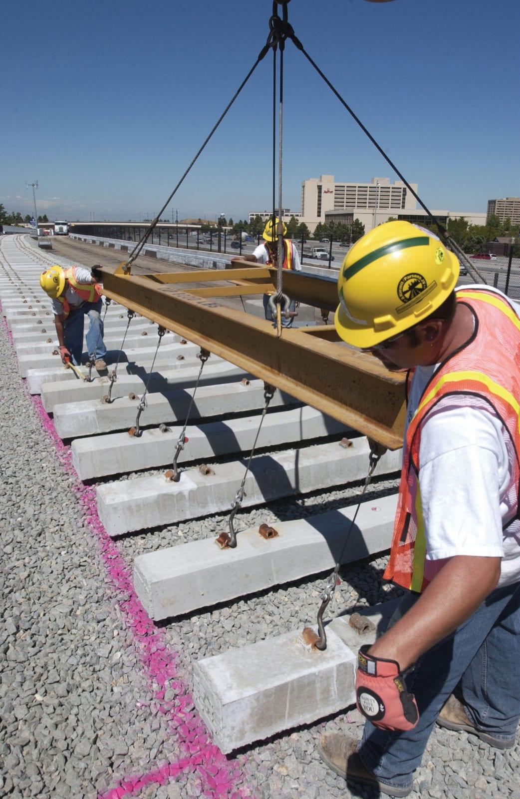 RTD Train Installing Railroad Tie
