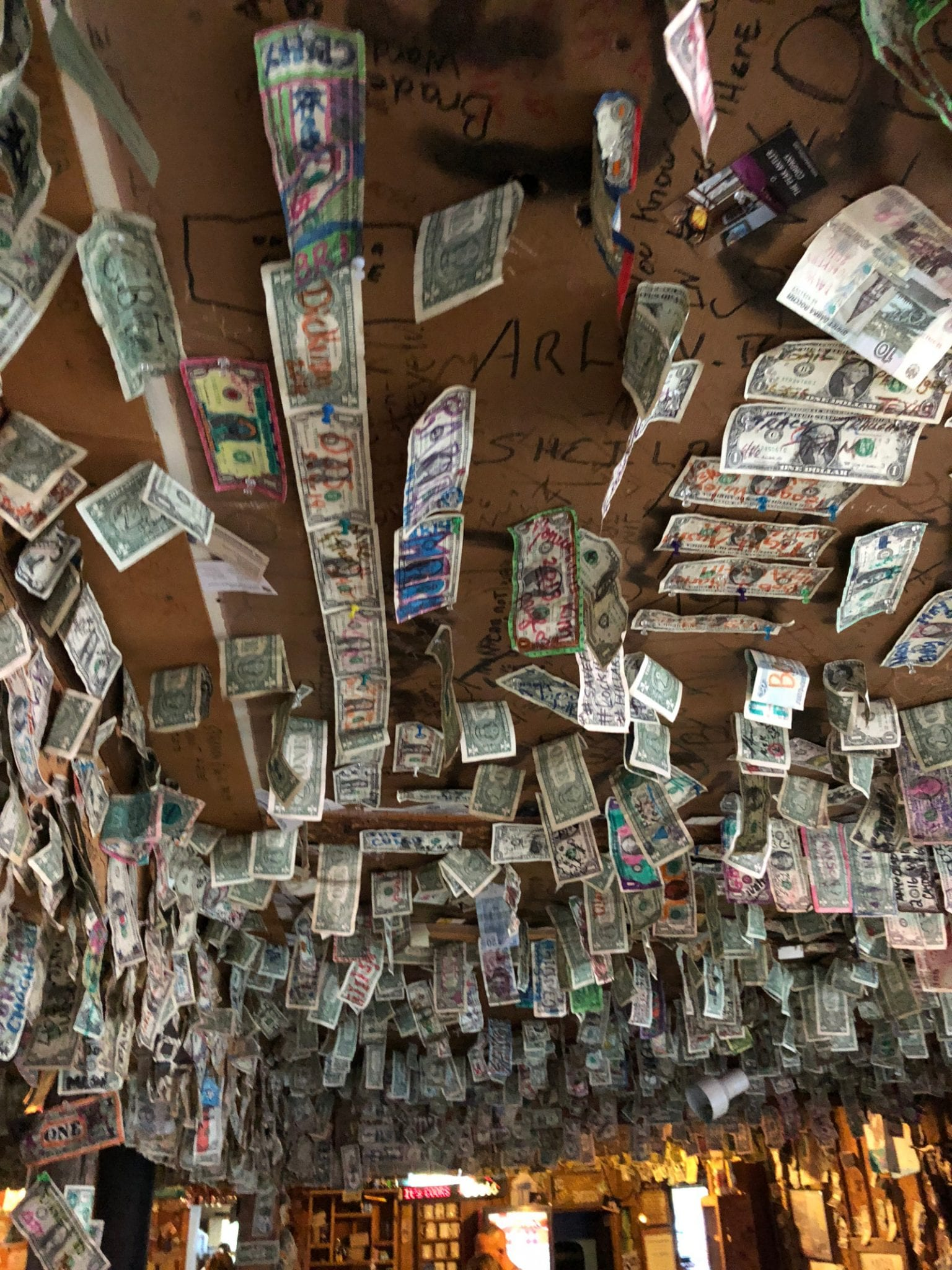 Bucksnort Saloon Dollar Bills on Ceiling