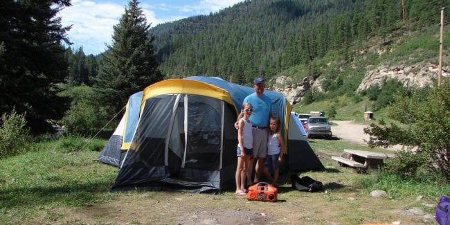 Camping with Kids Checklist Family at Campsite Rocky Mountains