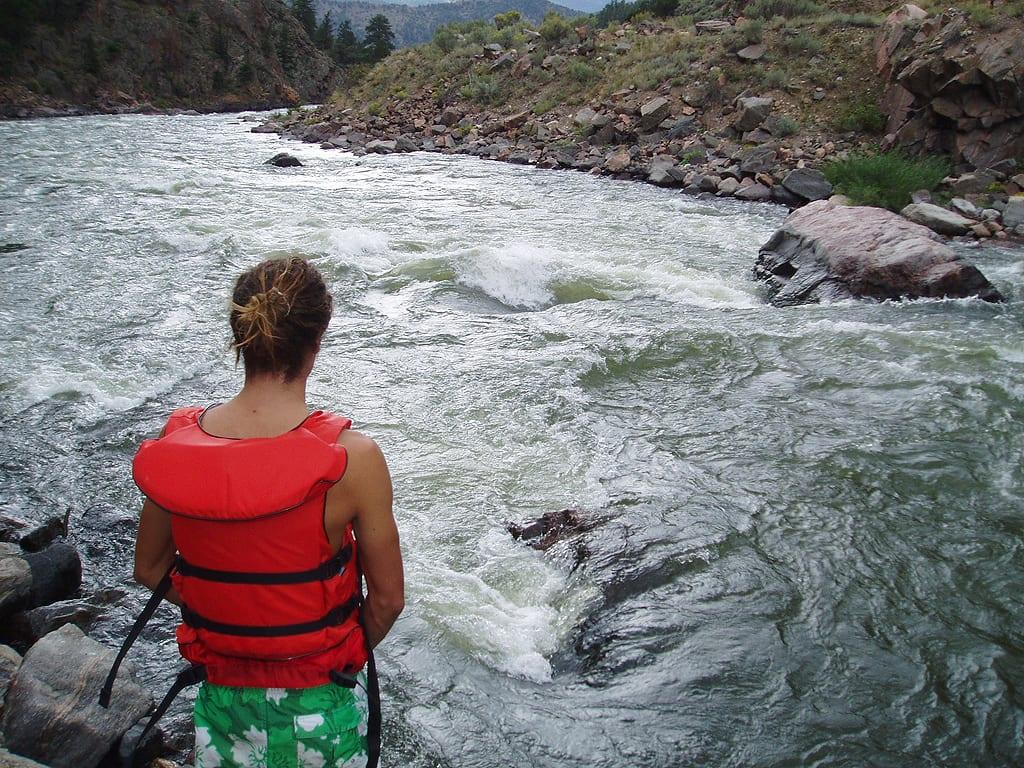 Kayaking Upper Colorado River Grand Colorado Class 2 Rapids Man Wearing PFD