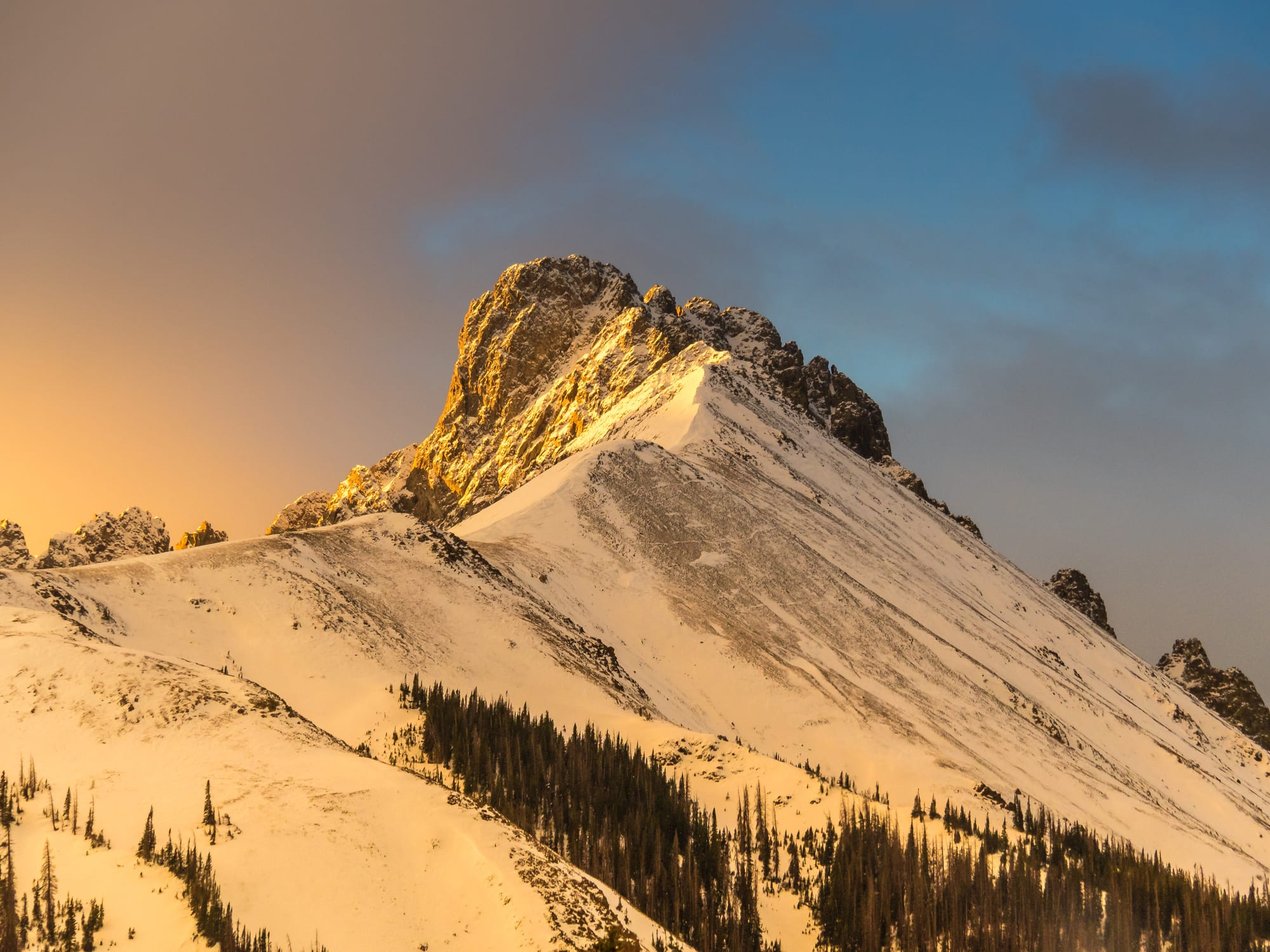 image of snowy mountain peaks on Cameron Pass