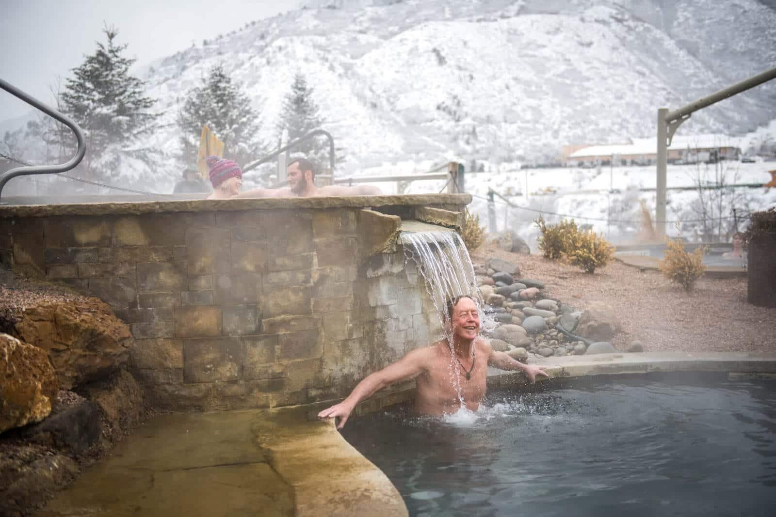 Iron Mountain Hot Springs Glenwood Springs Colorado Man Under Waterfall Pool