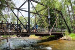 Top Aspen CO Hikes Rio Grande Trail Group Hikes Across Bridge Over River