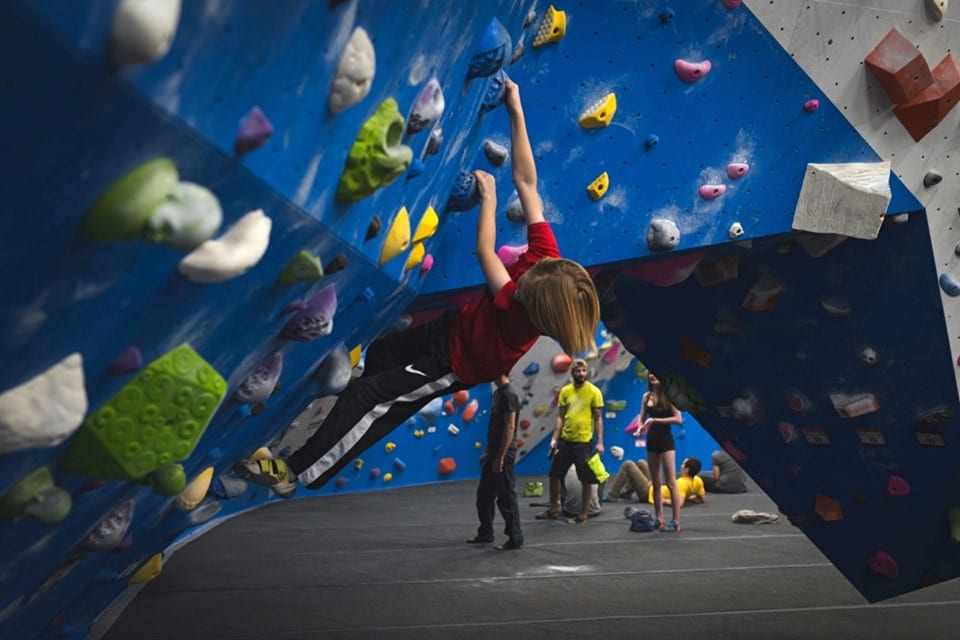 image of child bouldering