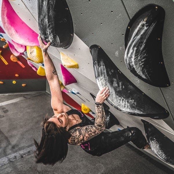 image of woman bouldering