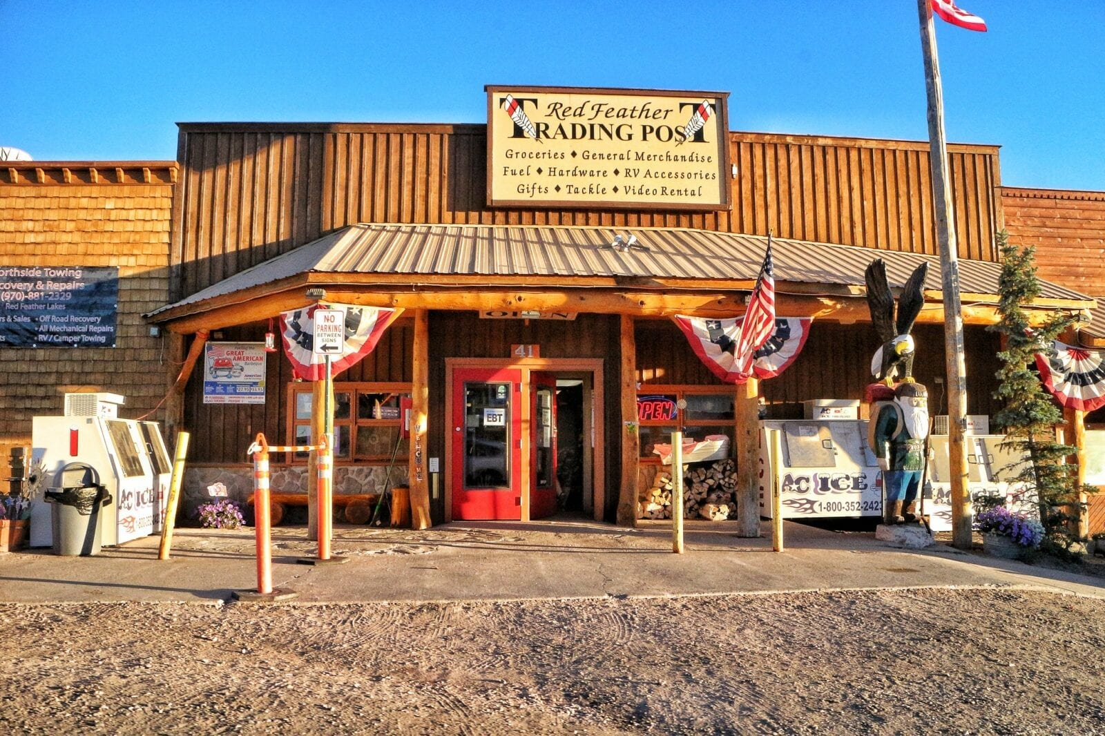 image of red feathers trading post