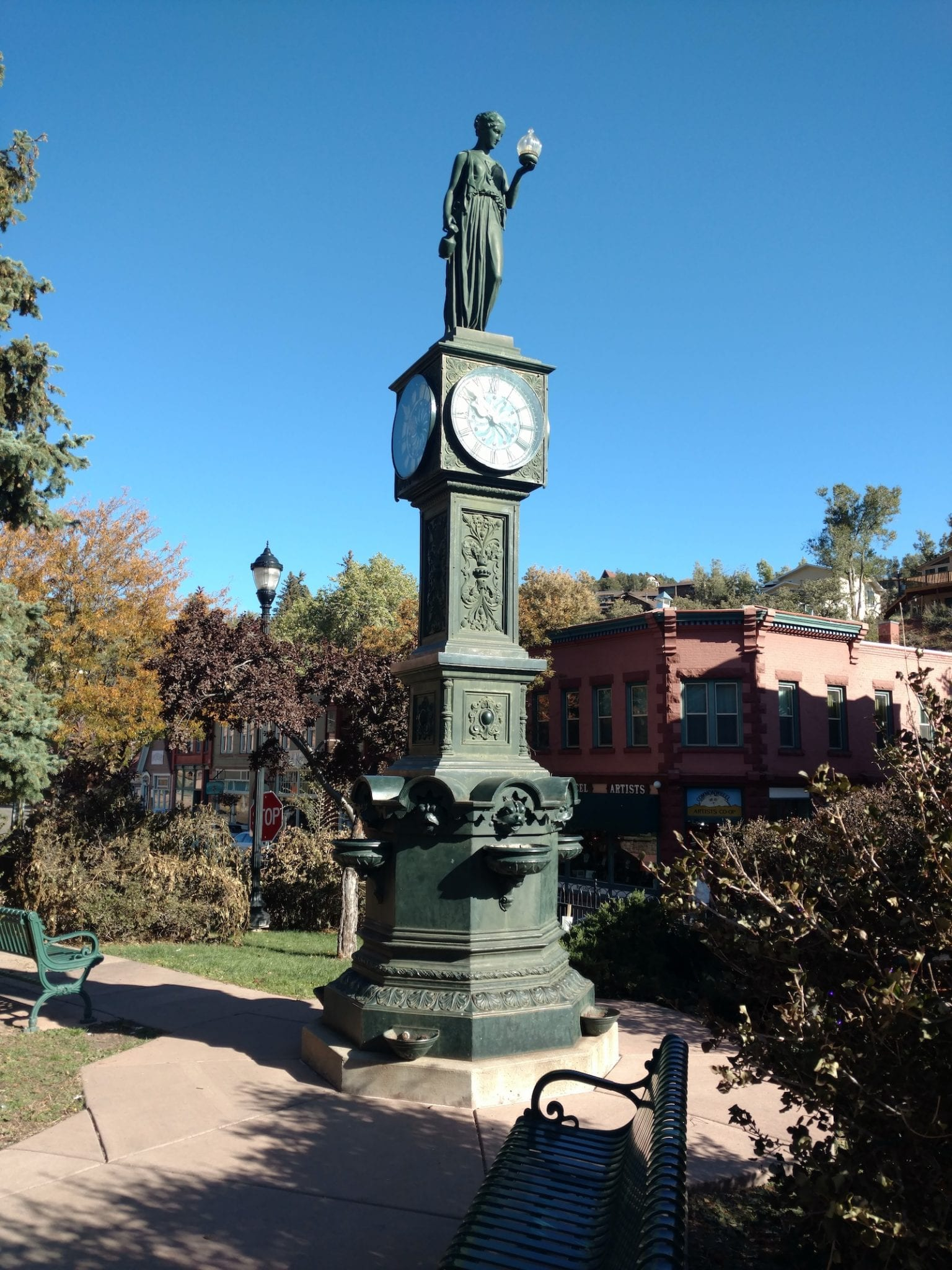 Town Clock With Skeleton in Tree Colorado Springs ArtWalk