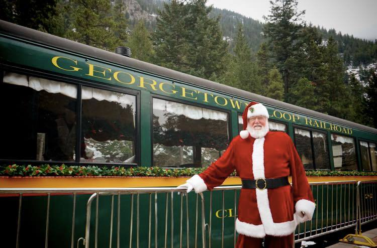 image of Santa in front of train