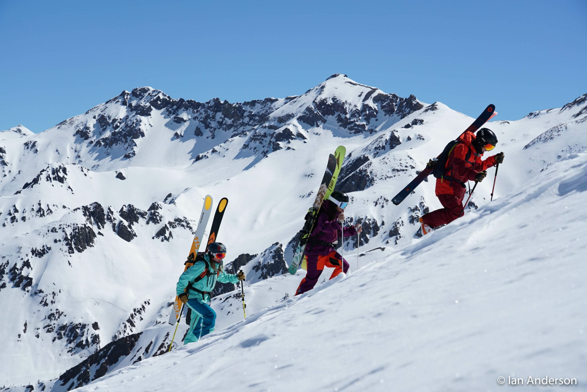 image of skiers hiking up mountain