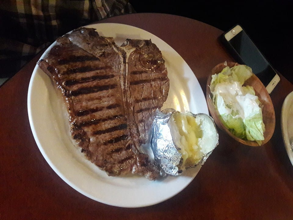 image of a steak and salad, columbine steakhouse