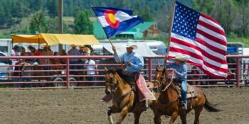 USA and Colorado Flags Pagosa Springs Rodeo
