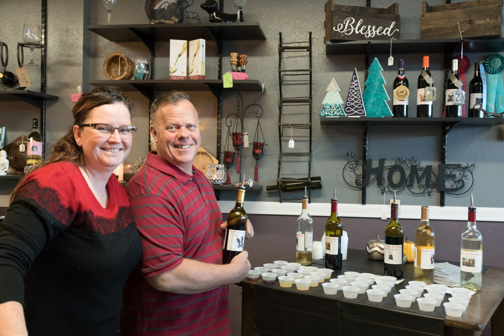 owners at reds wine boutique