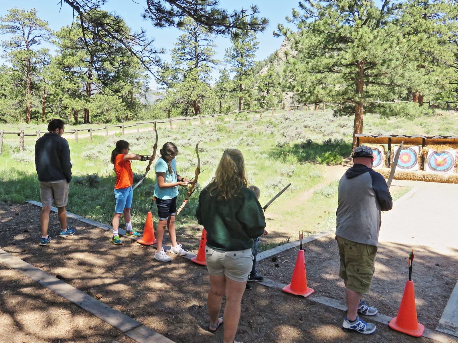 Shooting archery at YMCA of the Rockies, CO
