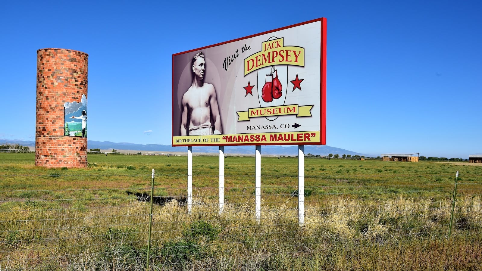 Jack Dempsey Museum Billboard at Exit Sign for Manassa CO