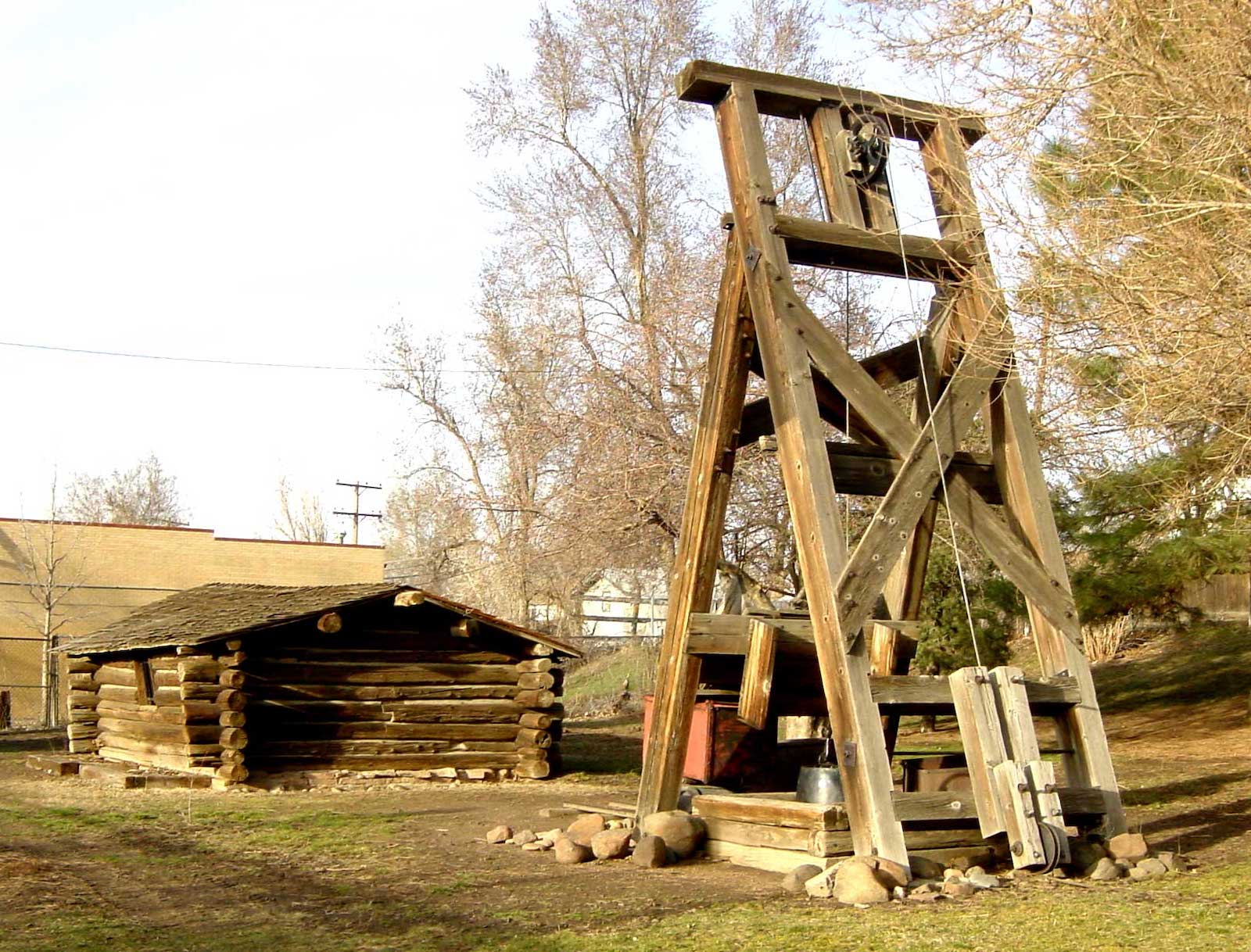 Montana City CO Reconstructed Cabin and Mine Headframe