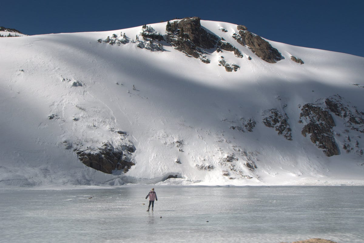 Person Walking On Ice by St Mary's Glacier Colorado