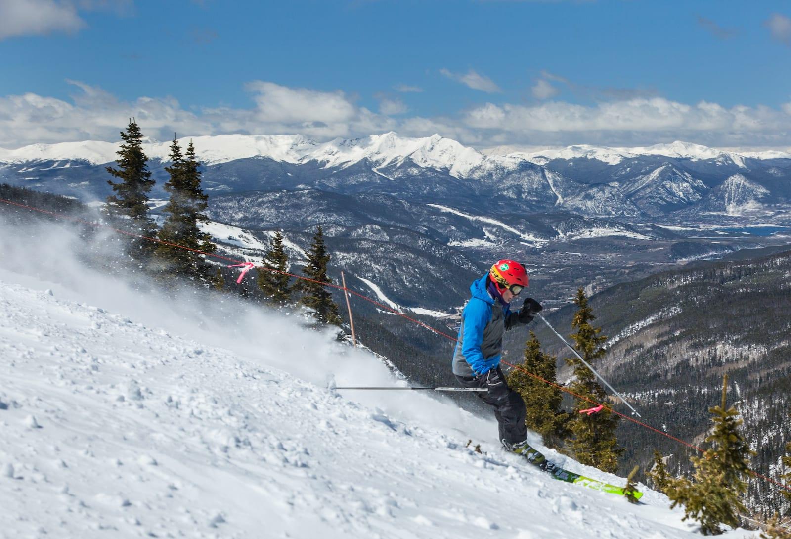 Arapahoe Basin Skier Keystone and Breckenridge Resorts in Background