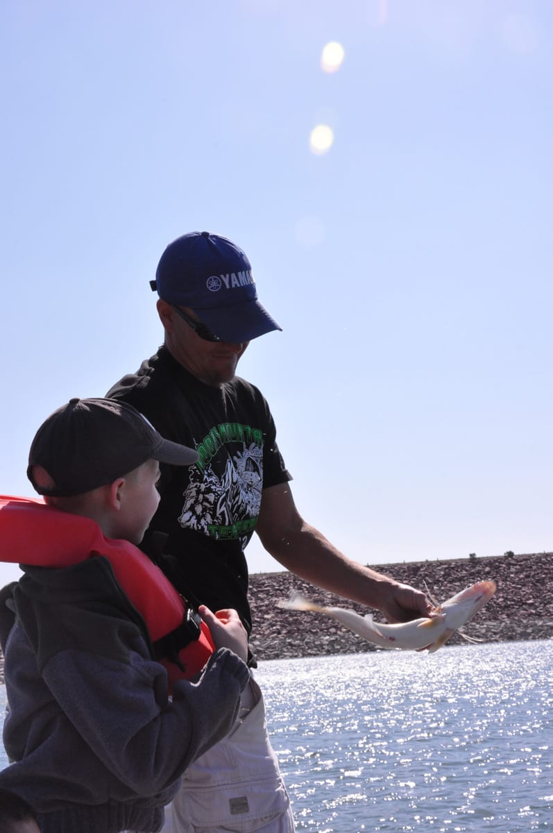 Kid and Adult Catch Fish at Pueblo Reservoir Colorado