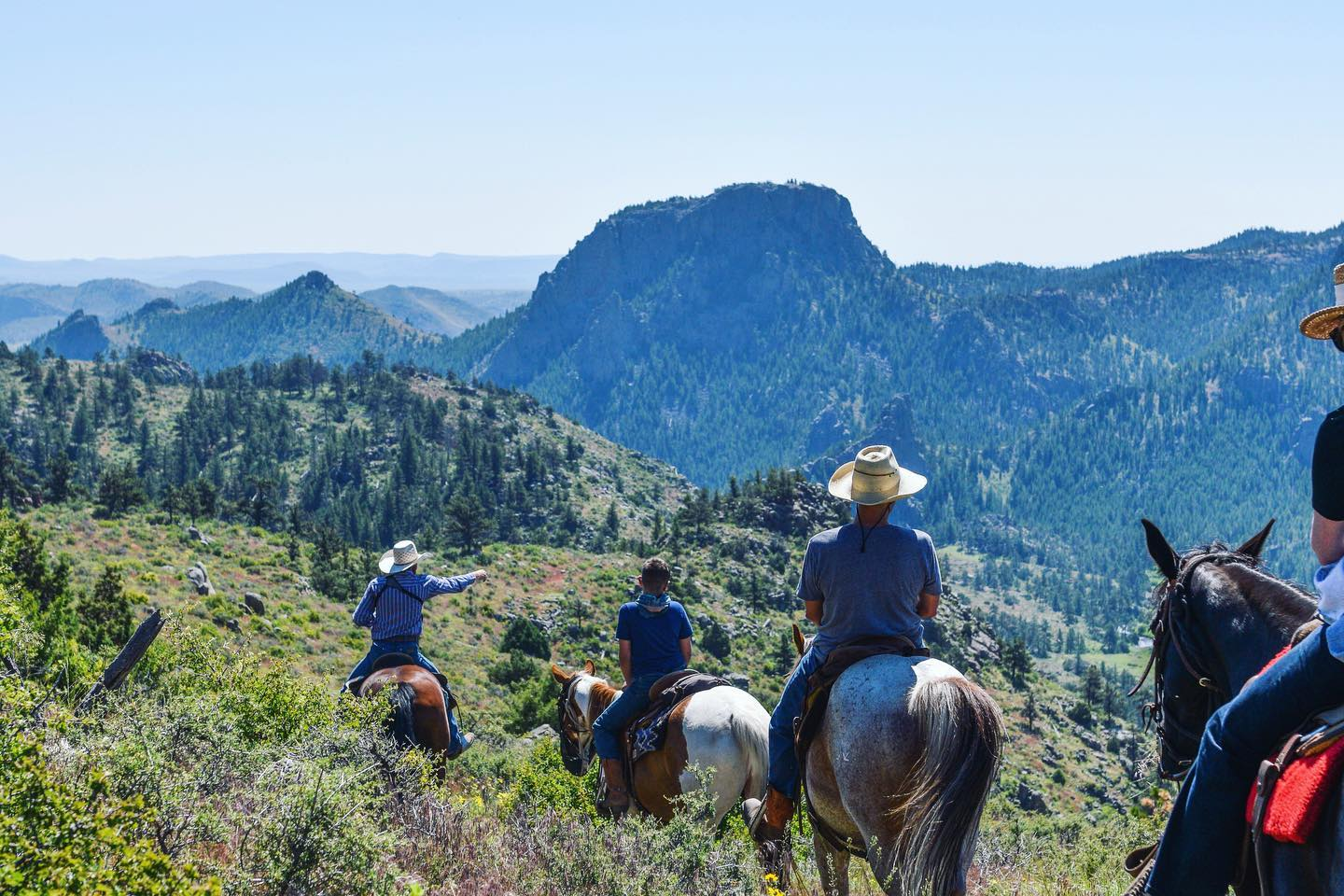 Image of horseback riders in the mountains at Cherokee Park Ranch, CO