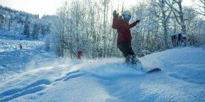 image of Powderhorn Resort Snowboarding through Powder