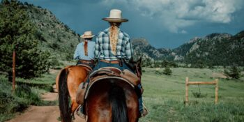 Image of two women riding horses at Cherokee Park Ranch in Colorado