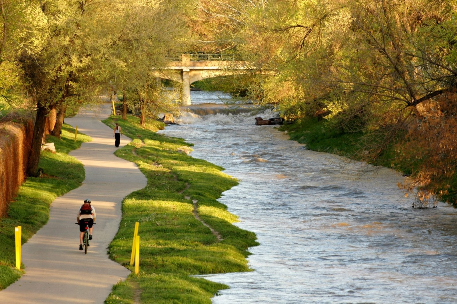 Image of a biker next to the Cherry Creek in Colorado
