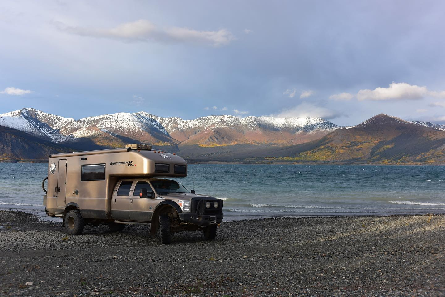 Image of the EarthRoamer XV-LT with Colorado's mountains in the background