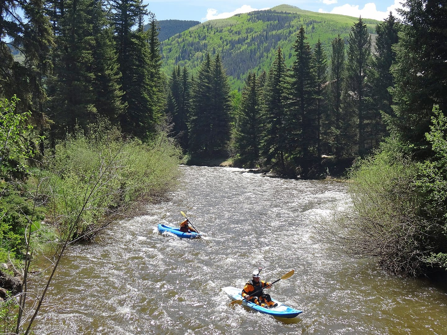 Image of kayakers on Gore Creek in Colorado near Vail
