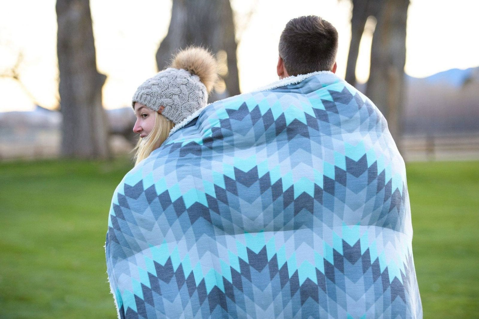 Image of a couple with a Holden & Hay blanket around them