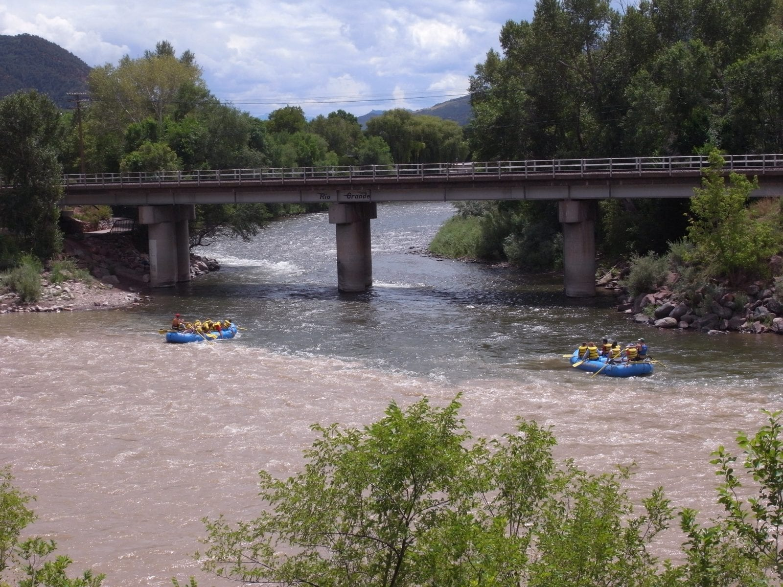 Image of two rafts floating down the Roaring Fork River in Colorado