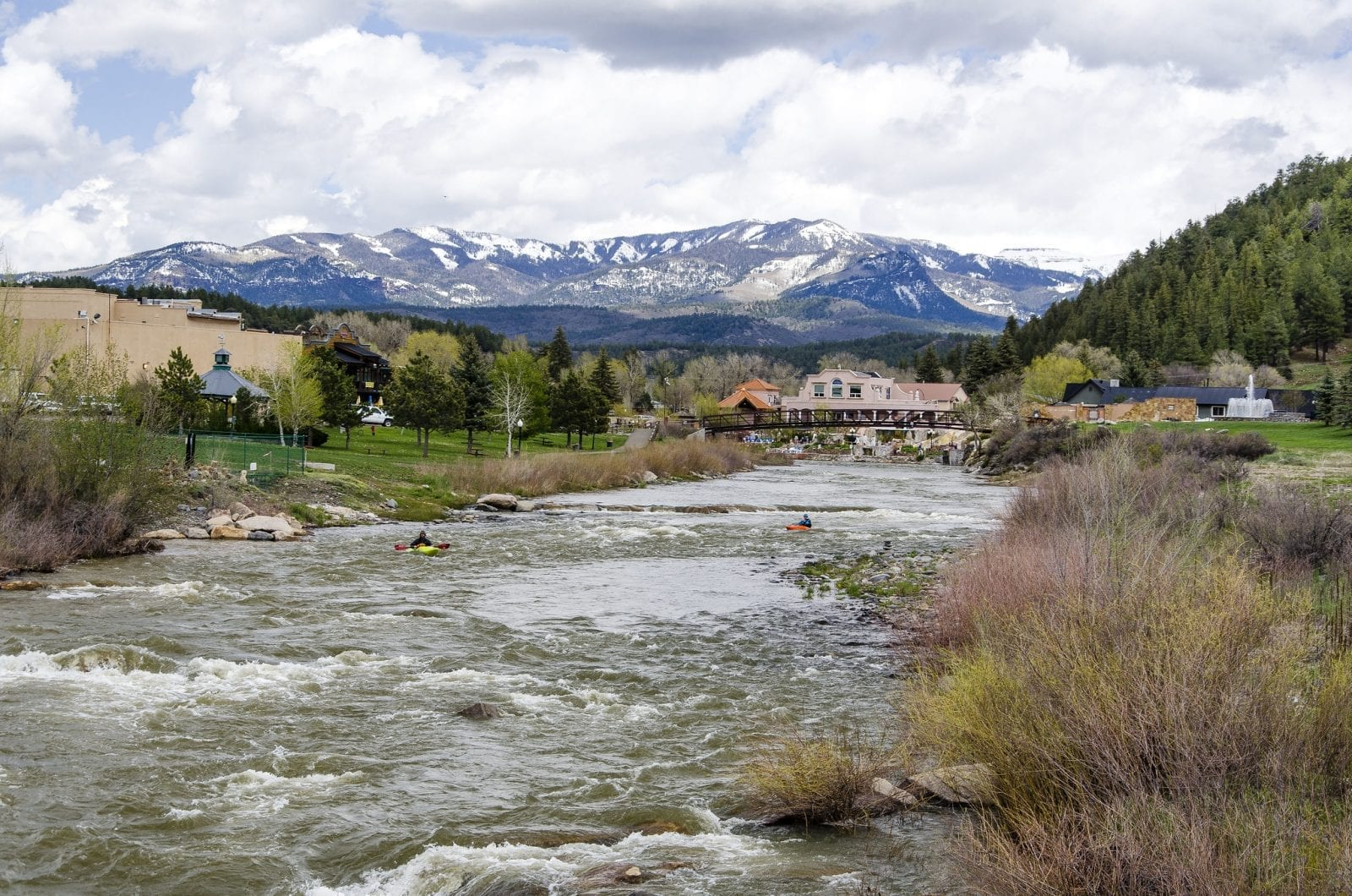 Image of the San Juan River flowing with mountains in the background in Colorado