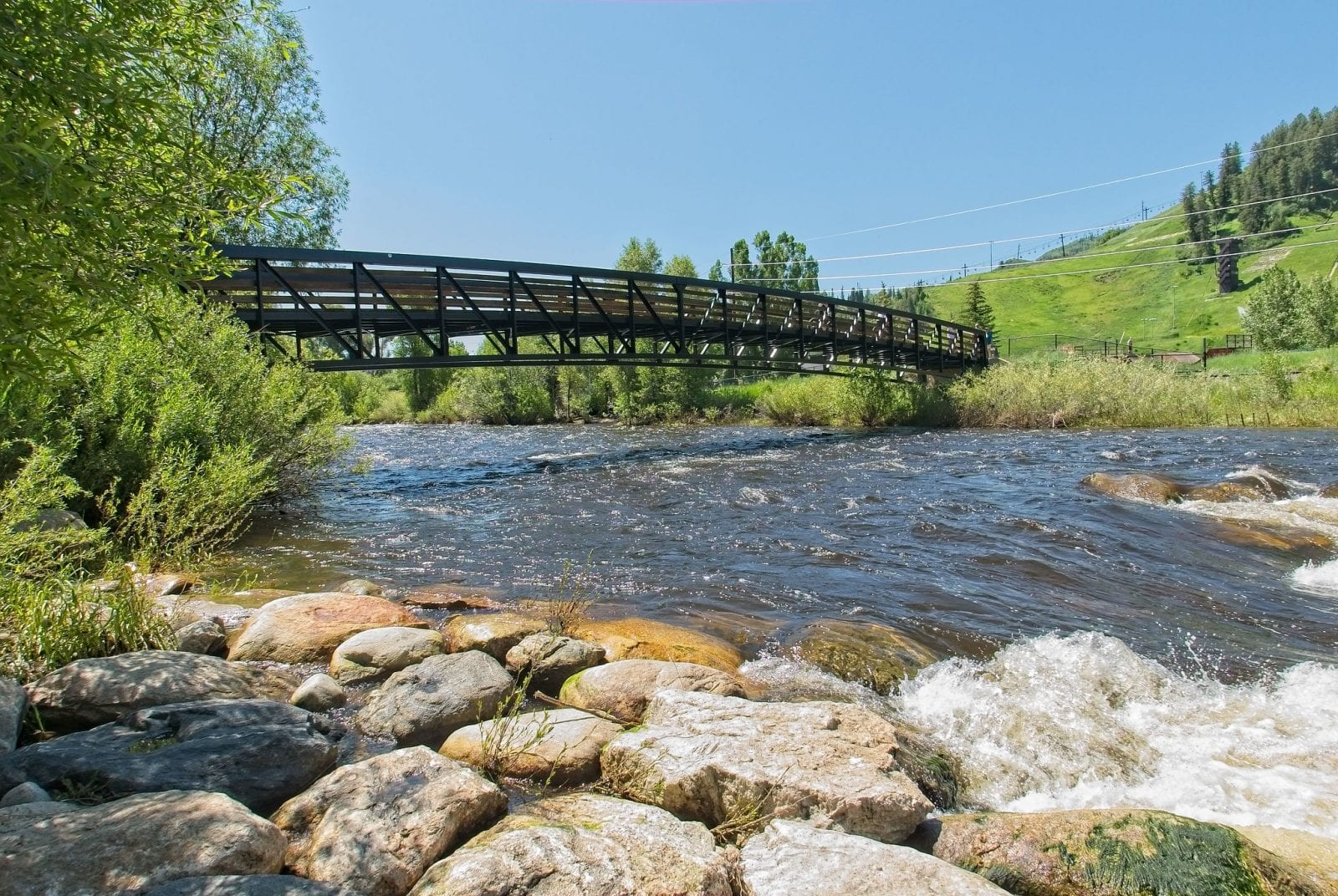 Image of a bridge going across the Yampa River near Steamboat Springs