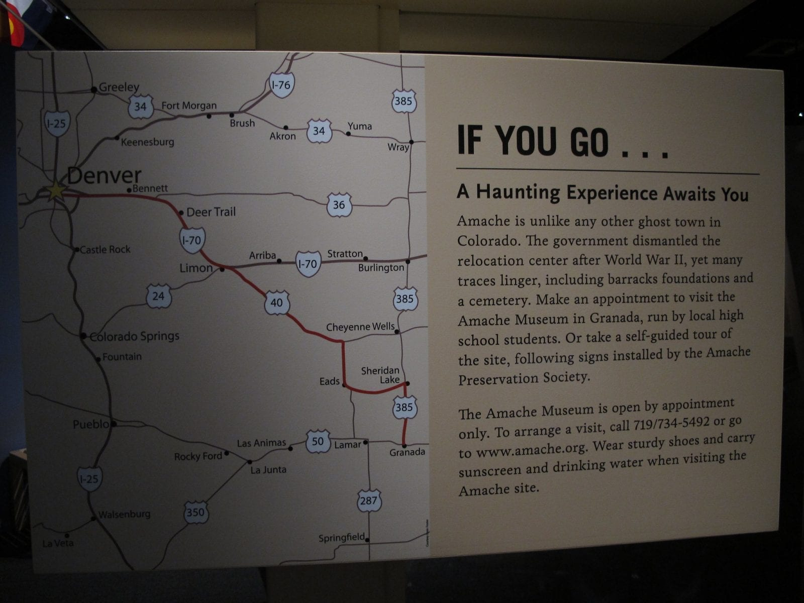 Image of a sign explaining how to get a tour at the Amache Museum in Colorado