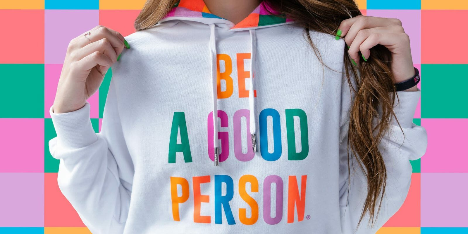 "Image of a girl wearing a ""Be A Good Person"" hoodie"