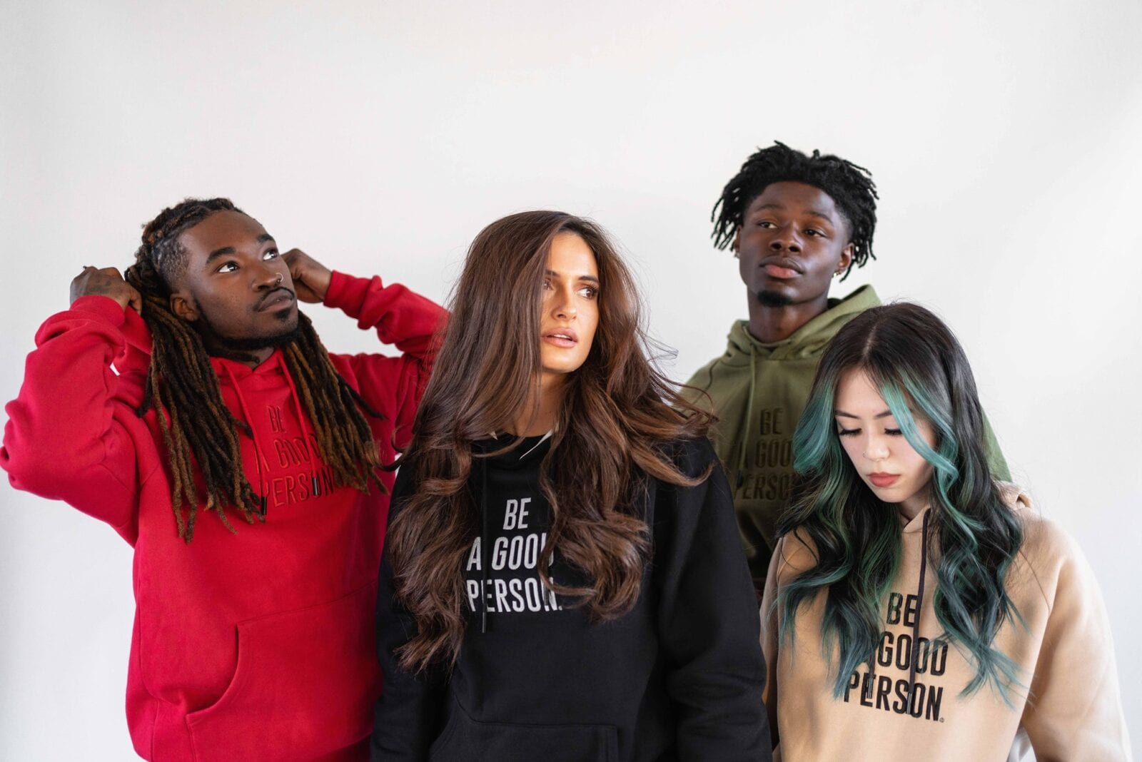 "Image of four people wearing ""Be A Good Person"" hoodies"