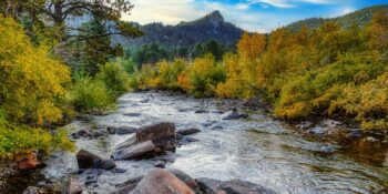 Image of the Big Thompson River surrounded by fall folliage