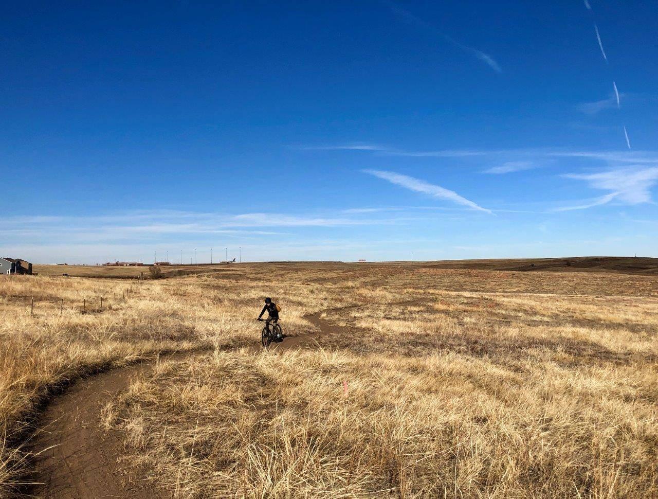 Image of a biker at the Bluestem Prairie Open Space in Colorado Springs, Colorado