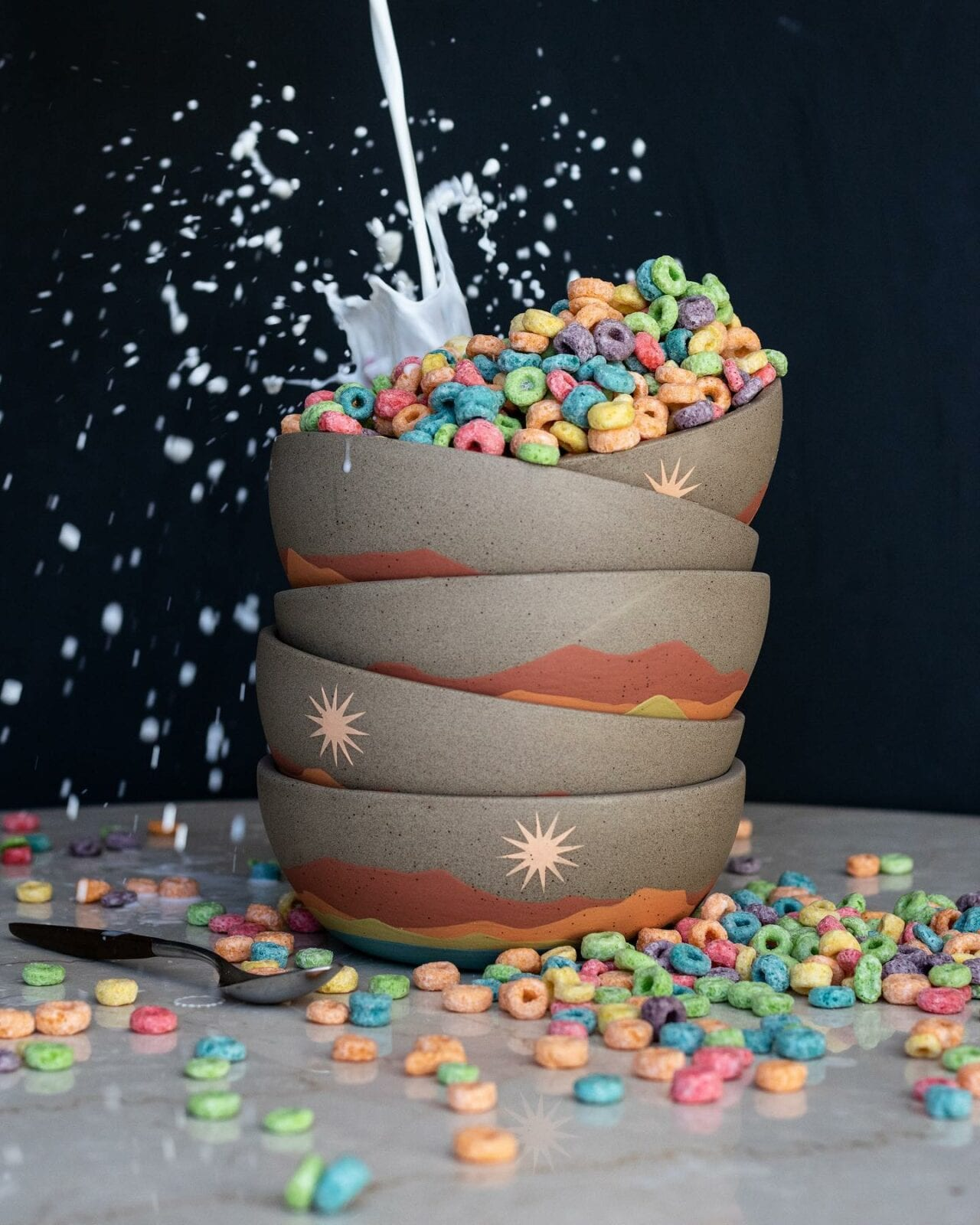 Image of the some Callahan bowls with Fruit Loops falling out