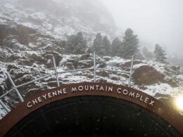 Image of the Cheyenne Mountain Complex Sign in Colorado Springs, Colorado during winter
