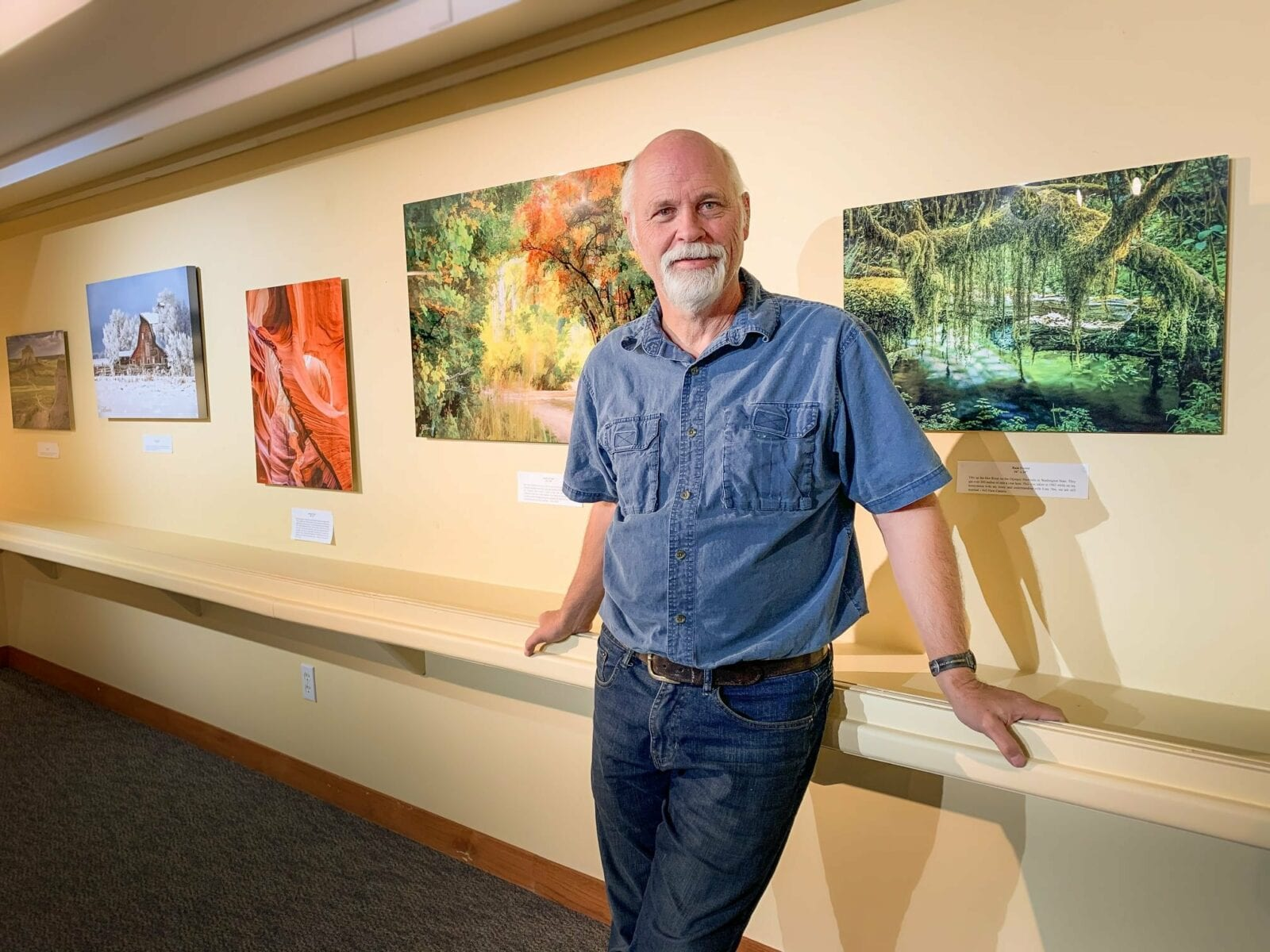 Image of a man in a painting gallery within the Fort Morgan Public Library & Museum in Colorado