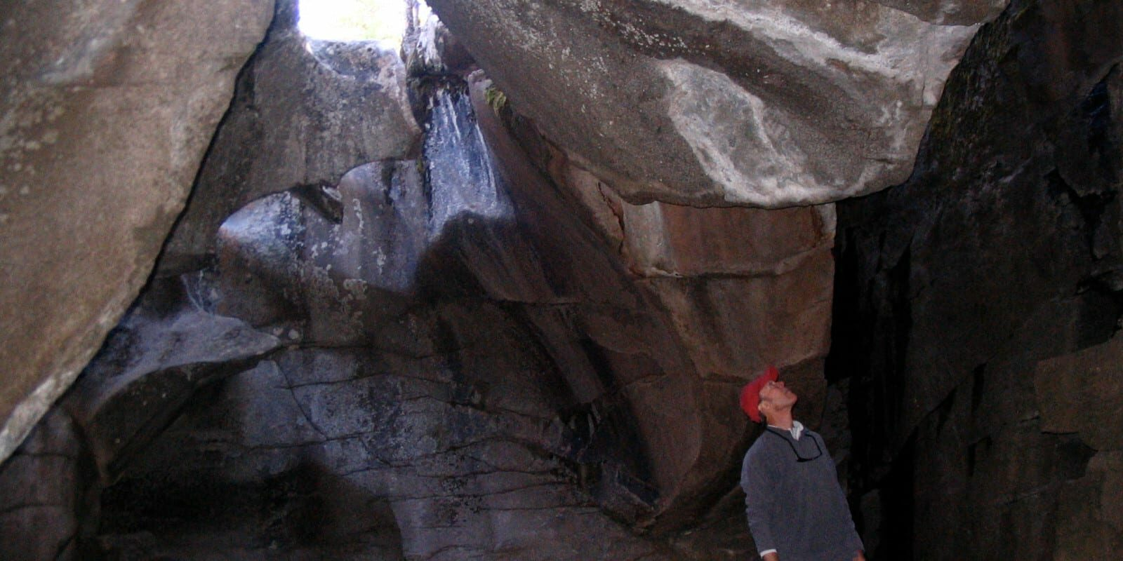 Image of a man in a cavern on the Grottos Trail in Aspen, Colorado