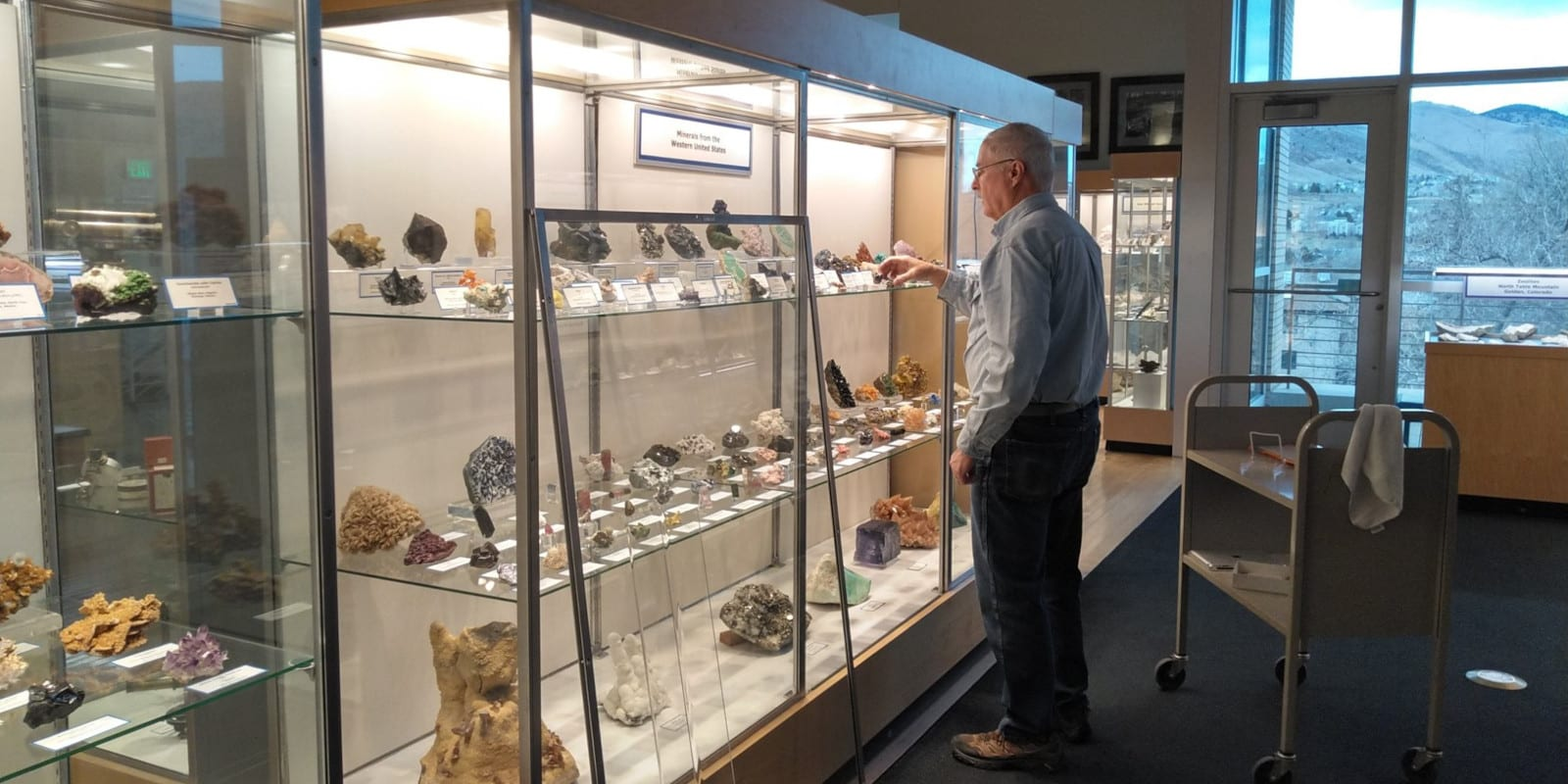 Image of a man installing an exhibit at the Mines Museum in Golden, Colorado