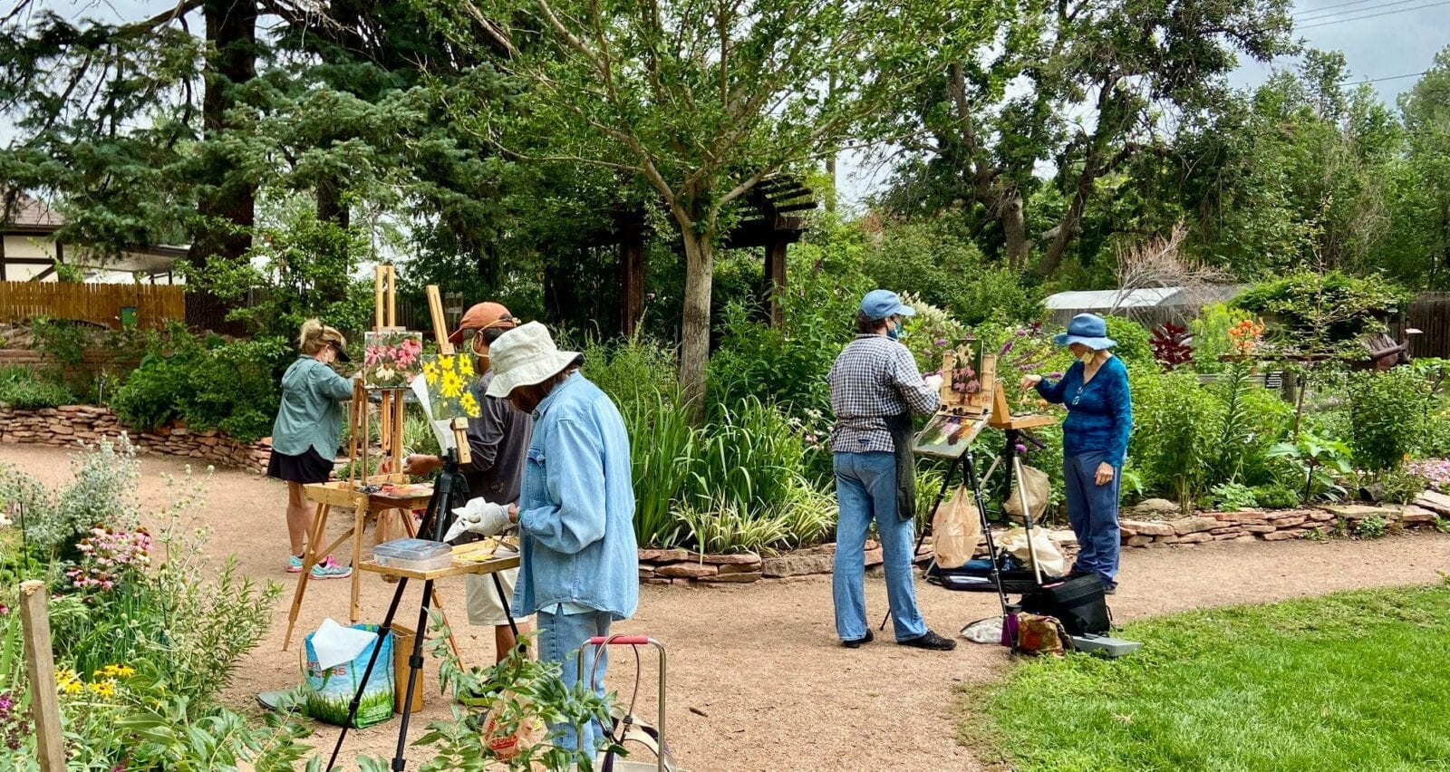 """Image of painters in the horticultural art society of colorado springs """"demo garden"""" at Monument Valley Park in Colorado Springs, Colorado"""