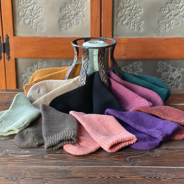 Image of socks on display at Phoenix Fiber Mill in Olney Springs, Colorado